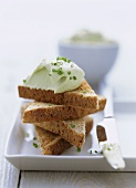 Wholemeal toast with soft cheese and avocado spread
