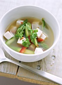 Miso soup with green asparagus, peppers and tofu