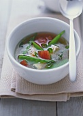 Miso soup with tofu, tomatoes and mangetout peas