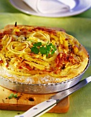 Savoury cheese and potato cake with apples and onions
