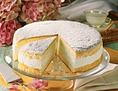 Cheesecake with icing sugar on glass plate
