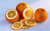 Oranges, whole and cut open, orange slices
