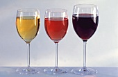 A glass of red wine, rose wine and white wine