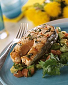 Grilled salmon cutlet on vegetables