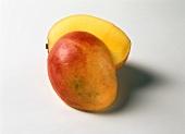 A mango, halved