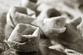 Uncooked tortellini (black and white photo)