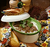 Duck rillettes in a stoneware pot