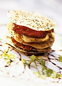 Crackers with sardines, tomatoes and poppy seeds