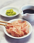 Sushi ingredients: bottled ginger slices, soy sauce and wasabi
