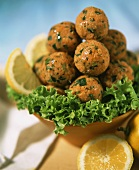 Bulgur and lentil balls on lettuce leaves