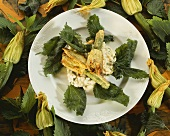 Nettle risotto with deep-fried courgette flowers