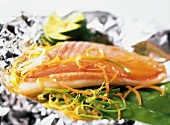 Red mullet with vegetables on aluminium foil