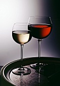 A Glass of Red Wine and a Glass of White Wine on Silver Tray