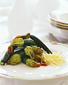 Courgettes with stuffed courgette flowers & parmesan cheese