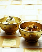 Bottled oranges and cardamom ice cream in bowls