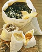 Pumpkin seeds, sunflower seeds and sesame in sacks