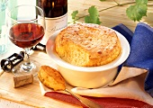 French cheese soufflé in dish and on spoon