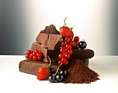 Still life with chocolate, cocoa powder and berries