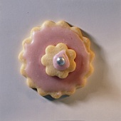 A pink pastry flower