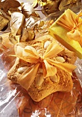 Almond cookies on gift wrapping foil