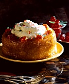 Baba au rhum with whipped cream