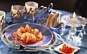 Salmon roll on a plate and keta caviare