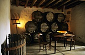 Spanish wine tavern with wooden barrels, table and candle