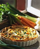 Tart with carrots and spring onions