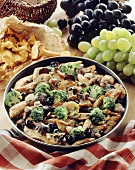 Pan-cooked chicken and broccoli dish with mushrooms and grapes
