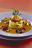Quail breast with potato & mango tower on mushroom sauce