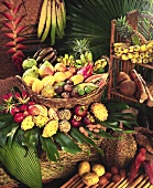 Various exotic fruits in and beside a basket