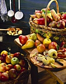 Apples and pears in willow baskets and on a table