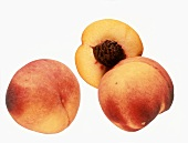 Two whole peaches and half a peach
