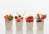 Four different yoghurt pots with vegetables