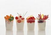 Four different yoghurt pots with vegetables