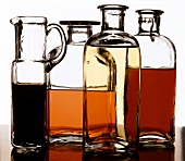 Types of vinegar and oil in bottles and carafe