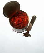 Red beans in opened tin, tin opener beside it