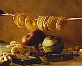 Still life with dried apple rings and apples