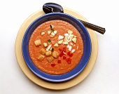 Cold tomato soup with vegetables, egg & bread cubes (gazpacho)