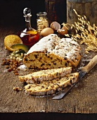 Christmas stollen on wooden background, slices cut