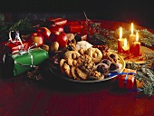 Christmas biscuits with gifts, apples and candles