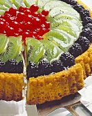 A kiwi fruit flan with berries