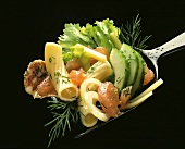 Pasta Salad with Vegetables on a Spoon, Close Up