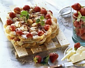 Strawberry cake with white chocolate on wooden rack