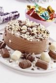 A chocolate gateau and chocolates