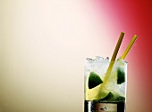 Caipirinha with lime and two straws