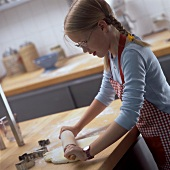 Girl baking biscuits