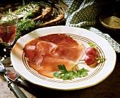 Westphalian ham with radishes on plate