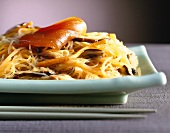 Fried glass noodles with strips of salmon