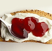 Wholemeal bread spread with quark and berry jam